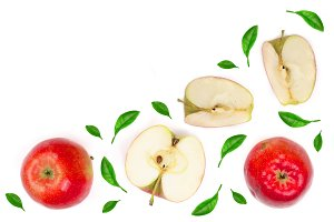red apples with slices decorated with green leaves isolated on white background top view with copy space for your text