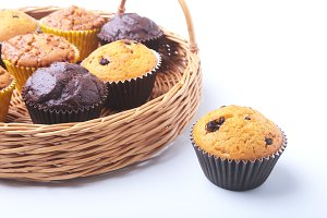Wicker basket with assorted delicious homemade cupcakes with raisins and chocolate. Cupcakes. Top View. Copy space.
