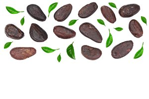 cocoa bean decorated with leaves isolated on white background with copy space for your text. Top view. Flat lay