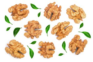 walnut kernels decorated with leaves isolated on white background. Top view. Flat lay