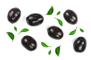 whole black olives isolated on white background. Top view. Flat lay pattern