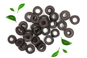 sliced black olives decorated with leaves isolated on white background. Top view. Flat lay pattern