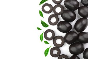 whole and sliced black olives decorated with leaves isolated on white background with copy space for your text. Top view