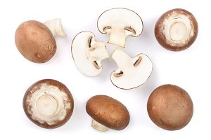 Fresh champignon mushrooms isolated on white background. Top view. Flat lay