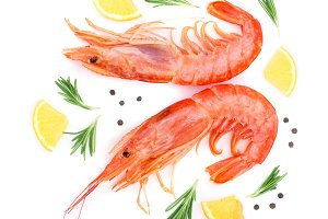 Red cooked prawn or shrimp with rosemary and lemon isolated on white background. Top view. Flat lay