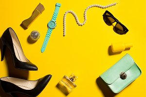 Still life of fashion woman, objects on yellow