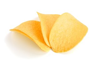 three potato chips on white background close-up