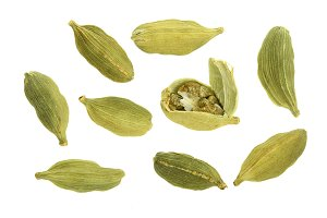 Green cardamom seeds isolated on white background. Top view. lay flat