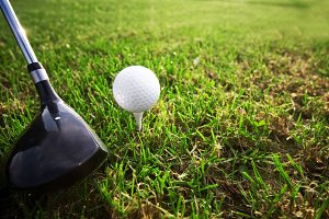 Playing golf - golf club and ball