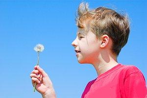 Boy with a dandelion