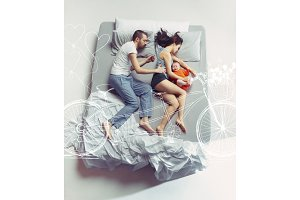 Top view of happy family with one newborn child in bedroom and their dreams .
