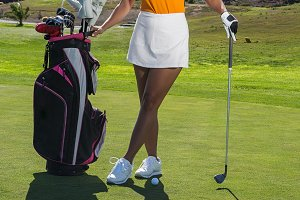 Cheerful stylish woman on golf cours