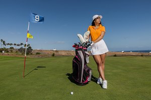 Stylish golf player on field