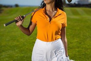 Beautiful golf player in skirt