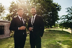 Groom and his friend at wedding