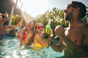 Group of happy friends at pool party
