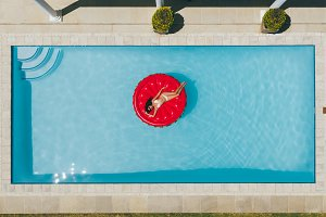 Woman floating on inflatable