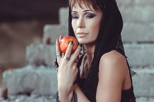 Woman with apple in abandon building