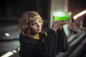 Witch with poison in bowl