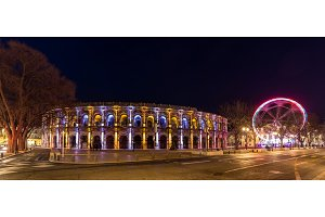 Roman amphitheatre - Arena of Nimes at evening - France, Langued