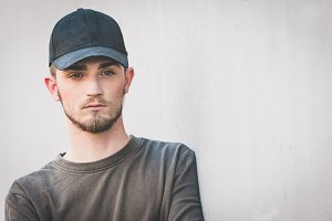 young bearded man wit cap