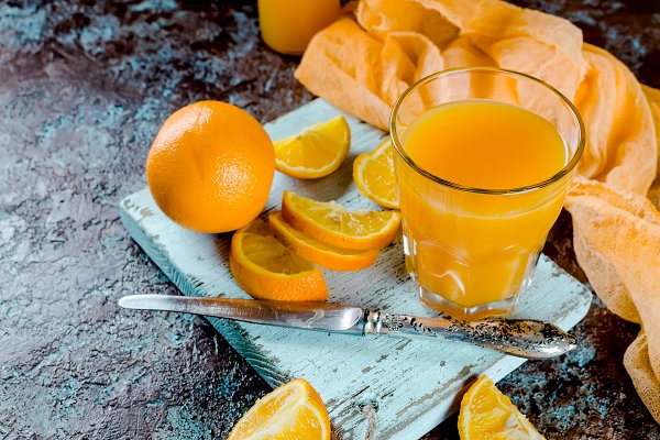 Food Stock Photos - orange juice in a glass and pieces