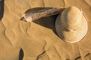 Summer hat on sand
