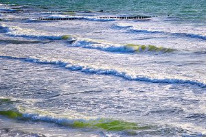 breaking waves rolling to beach