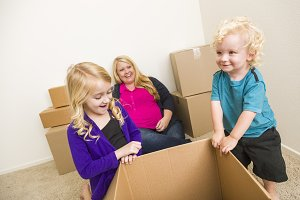 Young Family in Room With Boxes