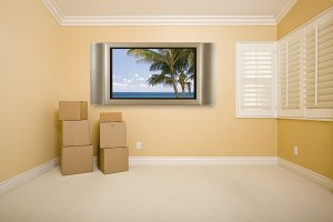 Television with Boxes in Empty Room