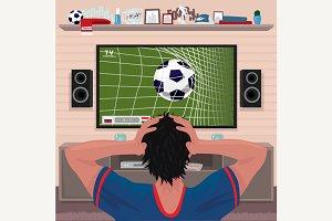 Football fan in despair after goal