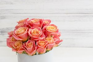 Beautiful pink roses in a round box.