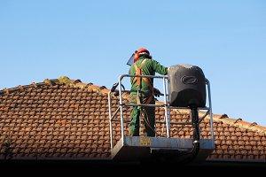 Construction worker on crane basket