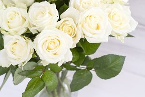 Bouquet of white roses in a vase.