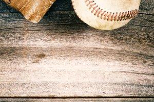 Old baseball and worn mitt