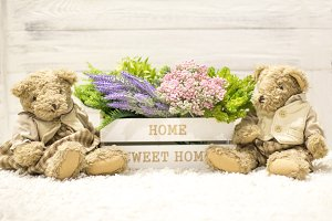Flowers in a wooden box and bears