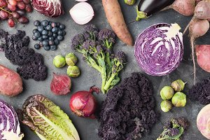 Vegetables background in purple