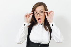 Shocked perplexed stress caucasian young brown-hair business woman in black suit, white shirt and glasses looking camera isolated on white background. Manager or worker. Copy space for advertisement.