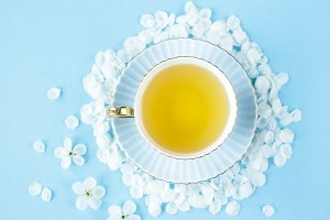 A cup of tea with spring petals