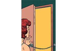 woman opens the door