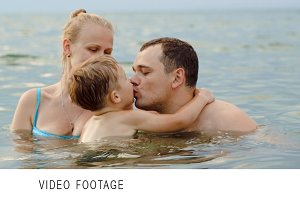 Lovely family with child bathing