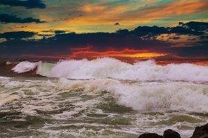 Panorama beautiful sunset foamy wave