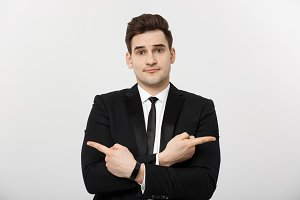 Business Concept: Portrait handsome young businessman point finger on side to empty copy space. Concept of advertisement product, isolated over white background
