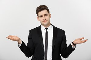 Business Concept: Portrait handsome young businessman point hands on side to empty copy space. Concept of advertisement product, isolated over white background.