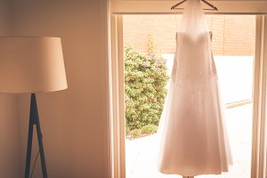 Hanging Wedding dress and lamp