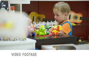 Boy playing with toys in game room