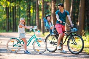 Happy family biking outdoors at the park