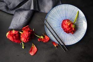 Table setting with red tulips