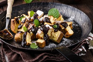 Cutted pancakes, Kaiserschmarrn delish dessert with plums