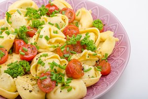 Filled tortellini with herbs, tomatoes
